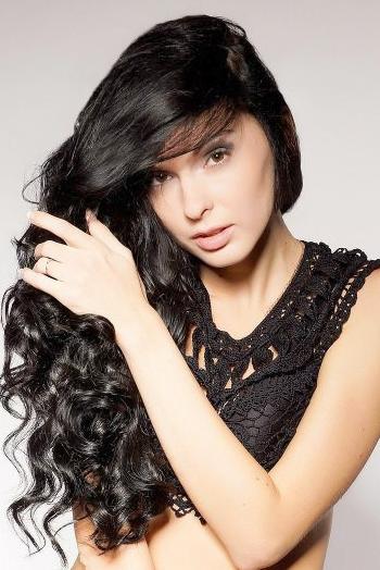 Ukrainian girl Nastya,28 years old with brown eyes and black hair.
