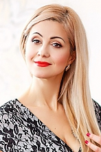 Ukrainian girl Elena,43 years old with brown eyes and blonde hair.