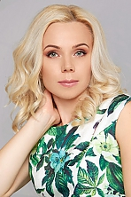 Ukrainian girl Valentina,35 years old with blue eyes and blonde hair.