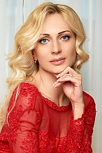 Ukrainian girl Julia,40 years old with grey eyes and blonde hair.