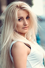 Ukrainian girl Oksana,25 years old with green eyes and blonde hair.