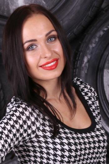 Ukrainian girl Irina,21 years old with blue eyes and dark brown hair.