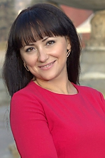 Ukrainian girl Tatiana,35 years old with brown eyes and dark brown hair.