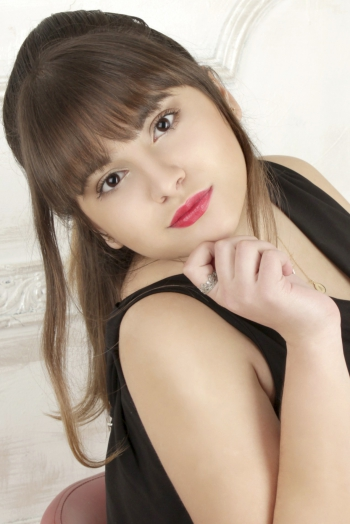 Ukrainian girl Alina,24 years old with brown eyes and light brown hair.