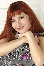 Ukrainian girl Viktoria,31 years old with brown eyes and red hair.