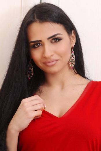 Ukrainian girl Karina,25 years old with black eyes and black hair.