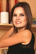 Ukrainian girl Alina,23 years old with brown eyes and dark brown hair.