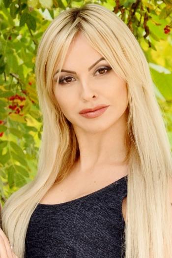 Ukrainian girl Ellina,26 years old with brown eyes and blonde hair.