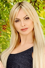 Ukrainian girl Ellina,27 years old with brown eyes and blonde hair.