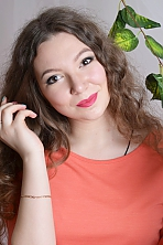 Ukrainian girl Vikroriya,21 years old with grey eyes and light brown hair.