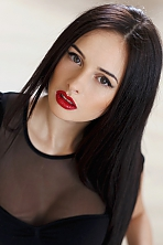 Ukrainian girl Svetlana,26 years old with green eyes and dark brown hair.
