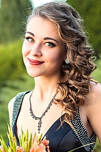 Ukrainian girl Alexandra,22 years old with brown eyes and light brown hair.