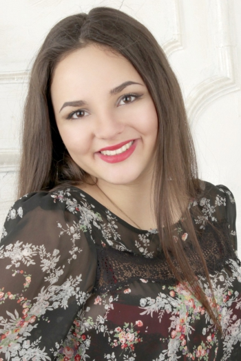 Ukrainian girl Irina,24 years old with brown eyes and dark brown hair.