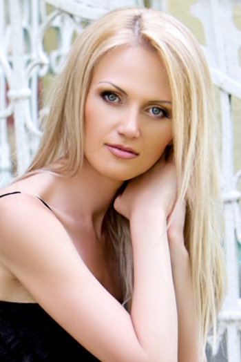 Ukrainian girl Viktoriya,38 years old with grey eyes and blonde hair.