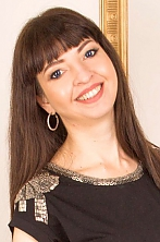 Ukrainian girl Helena,37 years old with blue eyes and black hair.