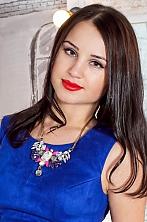 Ukrainian girl Alisa,27 years old with green eyes and dark brown hair.