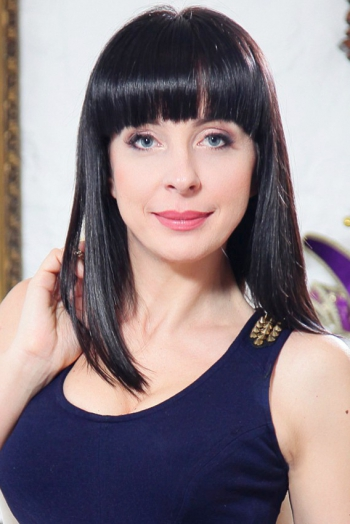 Ukrainian girl Lina,38 years old with blue eyes and dark brown hair.