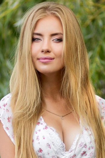 Ukrainian girl Irina,20 years old with blue eyes and blonde hair.