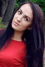 Ukrainian girl Iryna,22 years old with green eyes and dark brown hair.