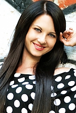 Ukrainian girl Valentina,30 years old with grey eyes and black hair.