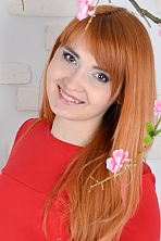 Ukrainian girl Tatyana,25 years old with green eyes and auburn hair.