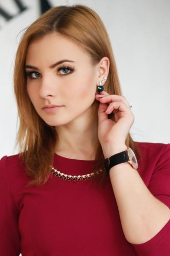 Ukrainian girl Tatyana,21 years old with green eyes and blonde hair.