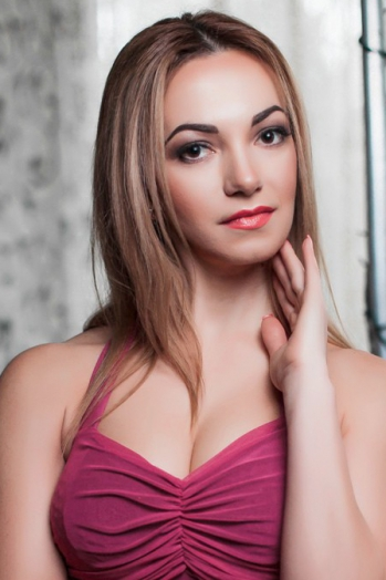 Ukrainian girl Oksana,37 years old with black eyes and blonde hair.