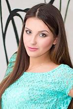 Ukrainian girl Anastasia,18 years old with green eyes and dark brown hair.