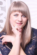 Ukrainian girl Larissa,22 years old with blue eyes and blonde hair.