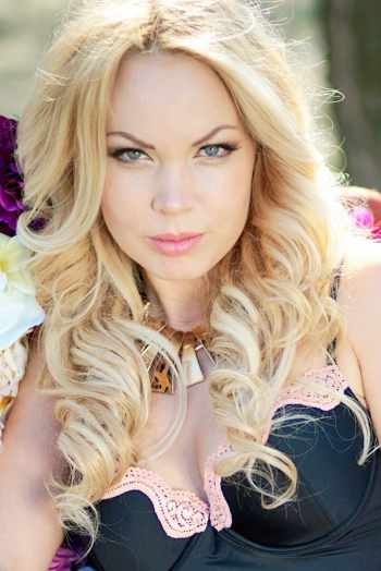 Ukrainian girl Veronika,31 years old with blue eyes and blonde hair.
