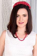 Ukrainian girl Anechka,23 years old with green eyes and dark brown hair.