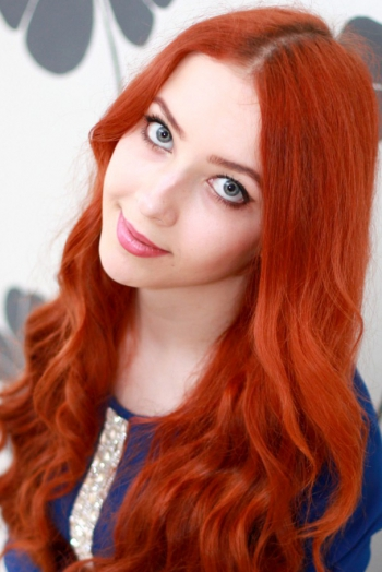 Ukrainian girl Ksenia,20 years old with grey eyes and red hair.