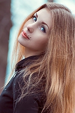 Ukrainian girl Lina,21 years old with black eyes and light brown hair.