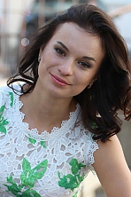Ukrainian girl Elena,21 years old with brown eyes and black hair.