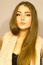 Ukrainian girl Daria,19 years old with hazel eyes and dark brown hair.