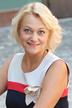 Ukrainian girl Svetlana,43 years old with blue eyes and blonde hair.