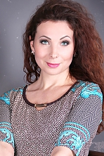 Ukrainian girl Marina,37 years old with green eyes and dark brown hair.