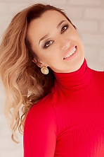 Ukrainian girl Julia,30 years old with blue eyes and blonde hair.