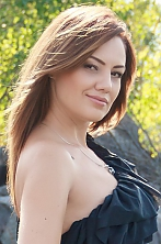 Ukrainian girl Marina,35 years old with brown eyes and dark brown hair.