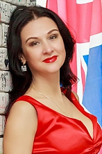 Ukrainian girl Victoria,40 years old with green eyes and dark brown hair.