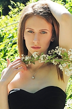 Ukrainian girl Veronika,21 years old with green eyes and dark brown hair.