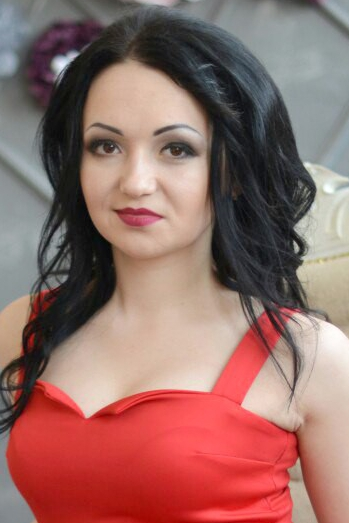 Ukrainian girl Anna,21 years old with hazel eyes and black hair.