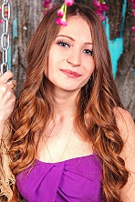 Ukrainian girl Irina,22 years old with blue eyes and dark brown hair.
