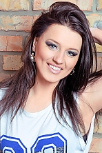 Ukrainian girl Oksana,30 years old with blue eyes and dark brown hair.