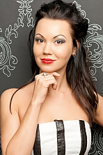 Ukrainian girl Alena,34 years old with brown eyes and black hair.