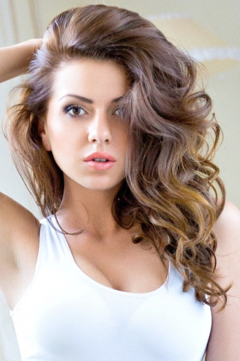 Ukrainian girl Eugenia,24 years old with brown eyes and dark brown hair.