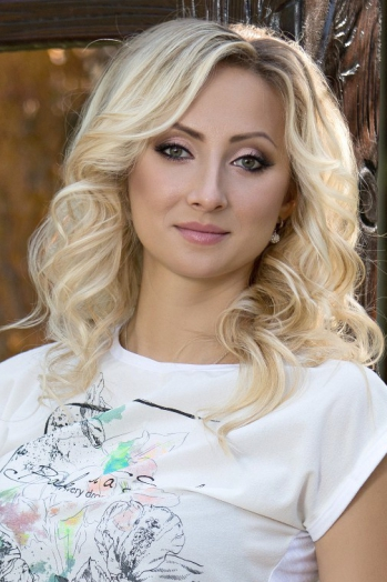 Ukrainian girl Aliona,26 years old with green eyes and blonde hair.