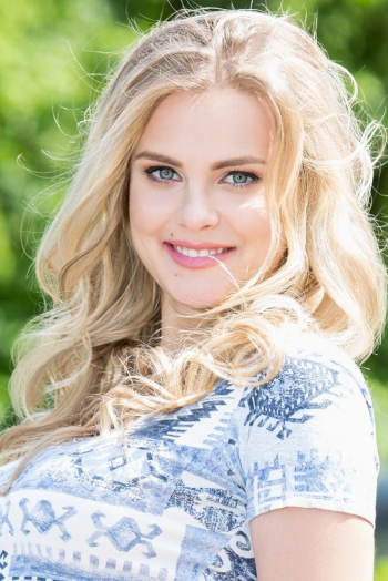 Ukrainian girl Viktoria,22 years old with green eyes and blonde hair.
