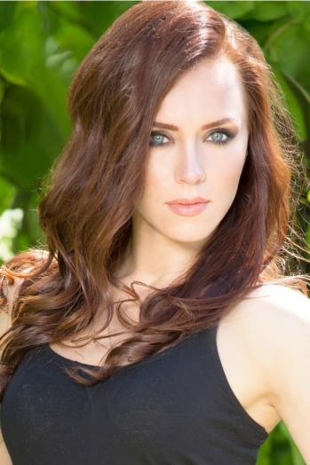 Ukrainian girl Viktoria,29 years old with blue eyes and dark brown hair.