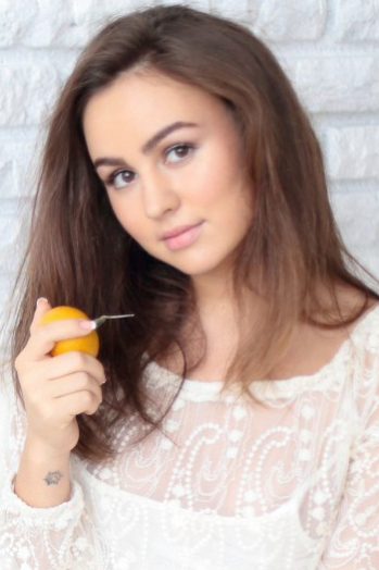Russian girl Yuliia,22 years old with brown eyes and dark brown hair.